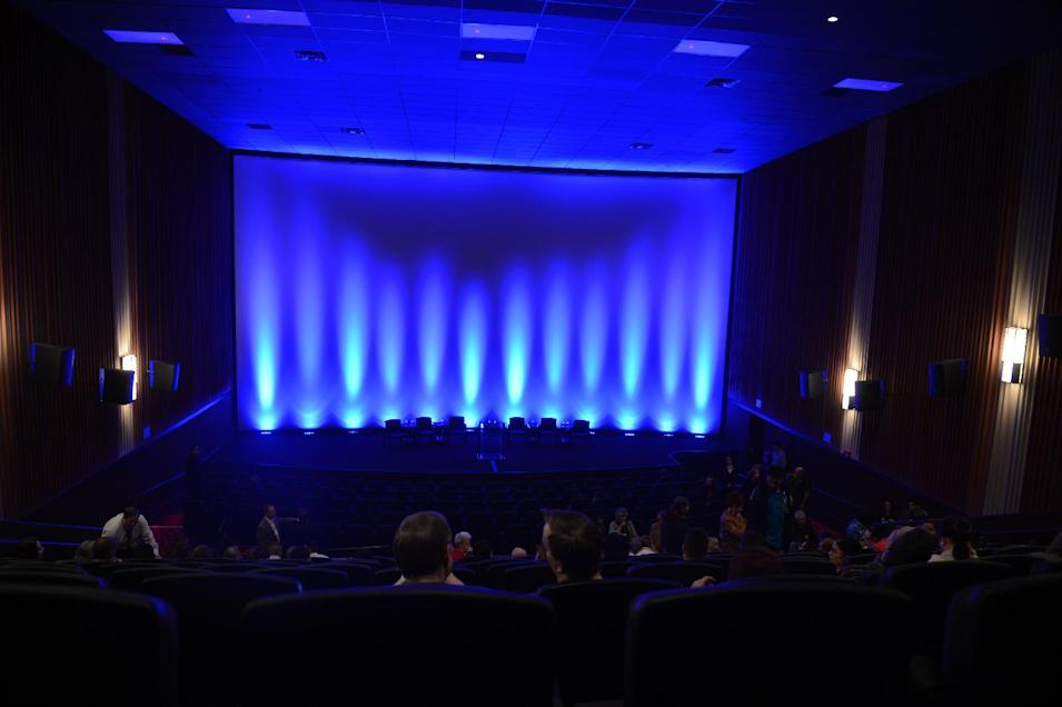 Guests take their seats at the Century Aurora cinema, formerly the Century 16, for a reopening and remembrance ceremony Thursday, Jan. 17, 2013 in Aurora, Colo. The cinema is where 12 people were killed and dozens injured in a shooting rampage last July. (AP Photo/The Denver Post, RJ Sangosti, Pool)