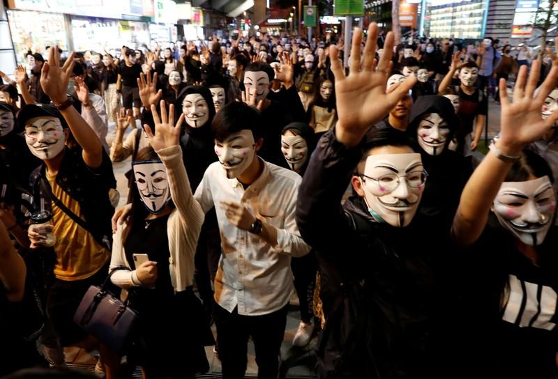 FILE PHOTO: Protesters wearing Guy Fawkes masks attend an anti-government demonstration in Hong Kong