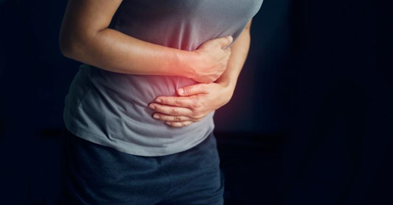Woman touching stomach painful suffering from stomachache causes of menstruation period, gastric ulcer, appendicitis or gastrointestinal system disease
