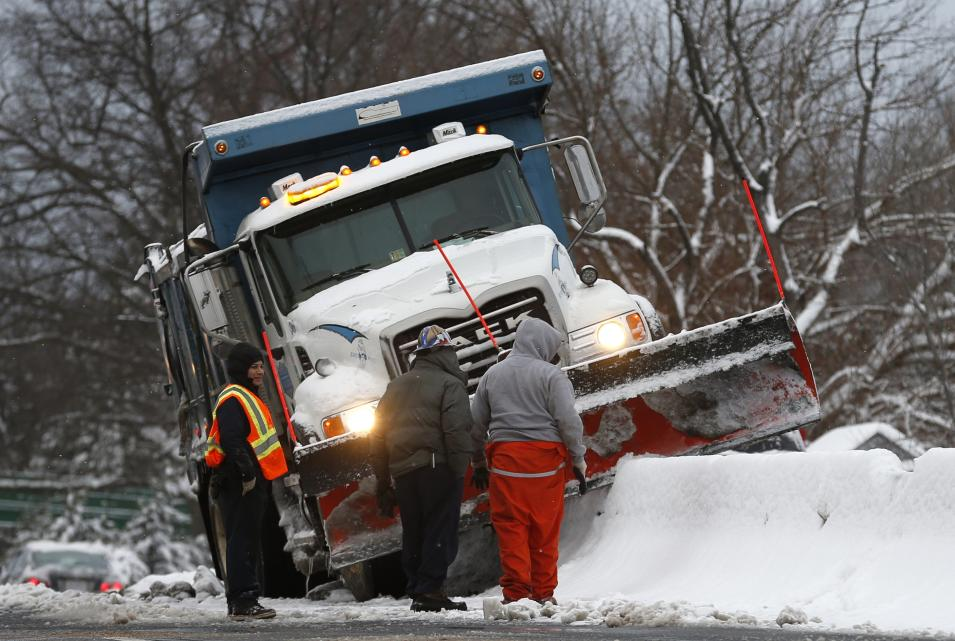 A snow plow is stuck upon a lane divider in Arlington, Virginia