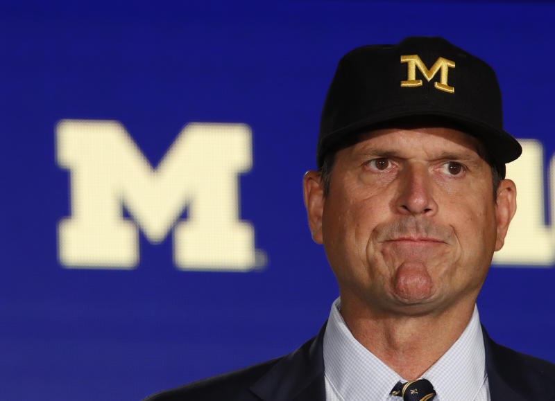 Michigan Wolverines head coach Jim Harbaugh needs to head back to the drawing board after a blowout loss to Wisconsin. (Getty)