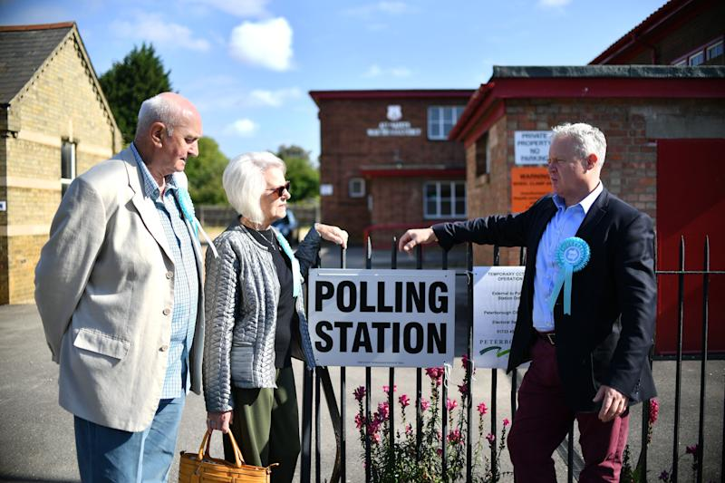 The Brexit Party's Mike Greene (right) outside a polling station in Peterborough (Photo by Joe Giddens/PA Images via Getty Images)