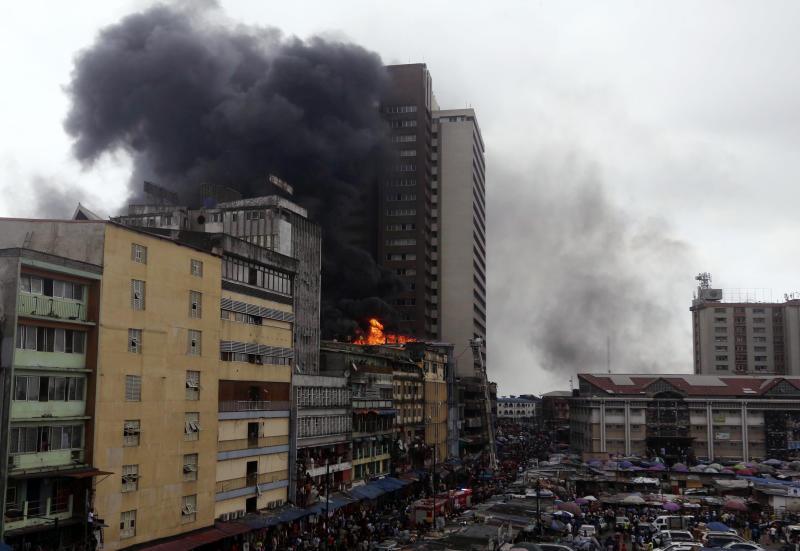 Smoke rises from a fire in downtown Lagos, Nigeria, Tuesday, Nov. 5, 2019. (Photo: Sunday Alamba/AP)