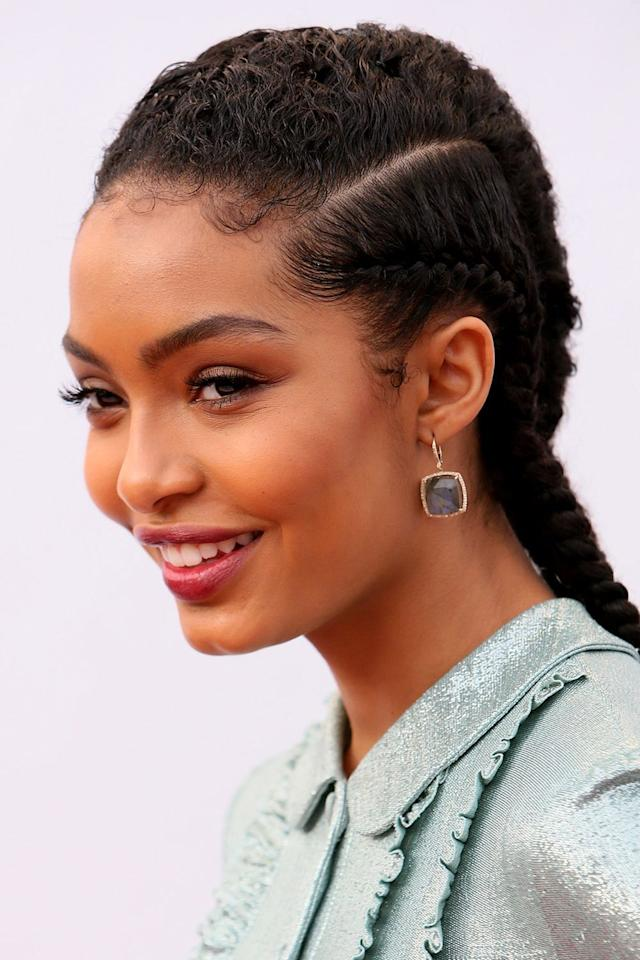 <p>Taylor says that if you're doing cornrows on natural hair, don't forget to detangle the hair as you braid. Once you've passed the scalp, you can continue to braid as normal and curl the ends around your finger to prevent them from unraveling (or use snap-free rubber bands or barrettes if you need). </p>