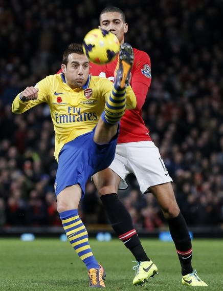 Manchester United's Smalling challenges Arsenal's Giroud during their English Premier League soccer match in Manchester