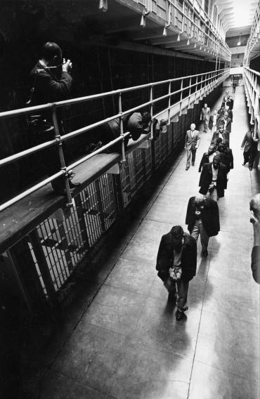 File - In this March 21, 1963 file photo the last prisoners depart from Alcatraz Island federal prison in San Francisco. The National Park Service on Thursday celebrated the 50th anniversary of Alcatraz Island's closure as a federal penitentiary with an exhibit of newly discovered photos of the prison's final hours.  The new display opened five decades after the last shacked prisoners were taken off the infamous prison in San Francisco Bay that once held the likes of gangsters Al Capone and Mickey Cohen. (AP Photo/File)