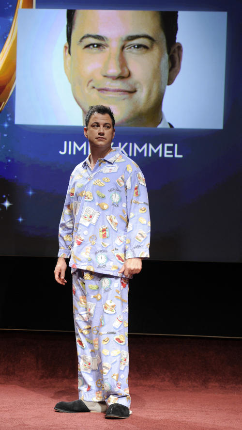 Comedian Jimmy Kimmel arrives onstage wearing pajamas and slippers before announcing the nominations for the 64th Primetime Emmy Awards at the Academy of Television Arts & Sciences in Los Angeles, Thursday, July 19, 2012. The 64th annual Primetime Emmy Awards will be presented Sept. 23 at the Nokia Theatre in Los Angeles, hosted by Kimmel and airing live on ABC. (Photo by Chris Pizzello/Invision/AP)