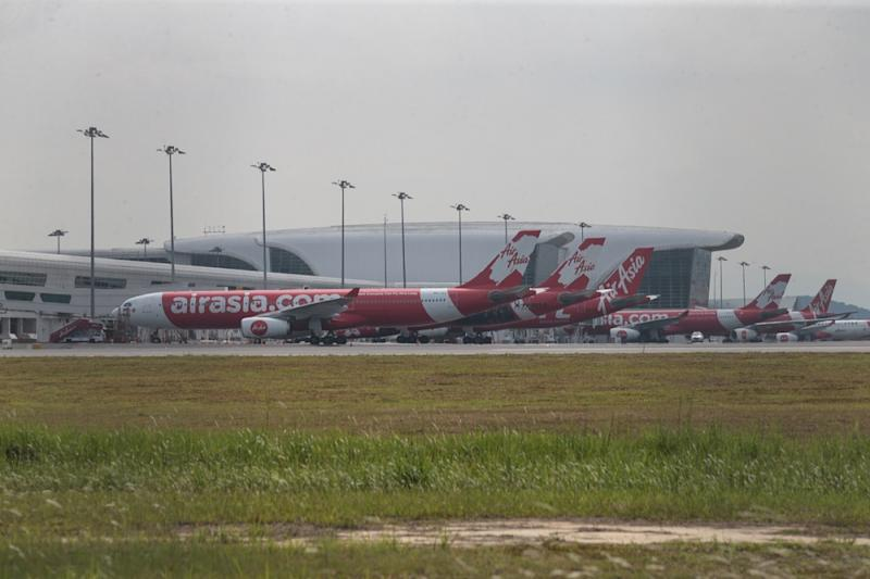 AirAsia planes are seen at the KLIA2 in Sepang June 17, 2019. — Picture by Ahmad Zamzahuri