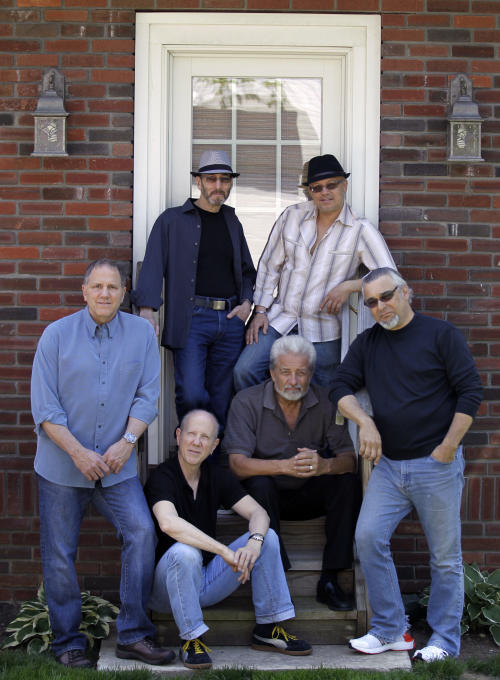 ADDS NAMES OF BAND MEMBERS -- Members of the Four Seasons band, front from left, Gary Polci, Jimmy Ryan, Don Ciccone, Lee Shapiro and rear from left, Larry Gates and Russ Valasquez, pose for The Associated Press, Sunday, May 13, 2012 in Fair Lawn, N.J. Former members of the Four Seasons, minus lead singer Frankie Valli, have teamed up with some A-list studio musicians and have been rehearsing in Gates' basement in preparation for a nationwide tour. (AP Photo/Julio Cortez)