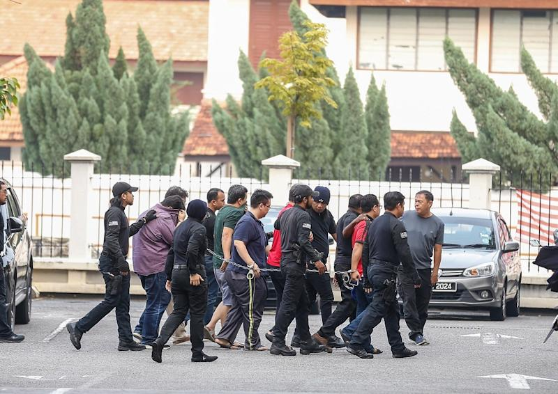 Six personnel from the National Registration Department is led to George Town Sessions Court September 12, 2019. — Picture by Sayuti Zainudin