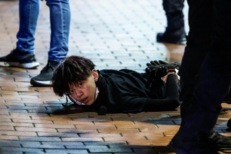 In the evening, clashes spilled into the streets, with police using batons and pepper spray in the busy commercial neighbourhood of Mong Kok and making more arrests