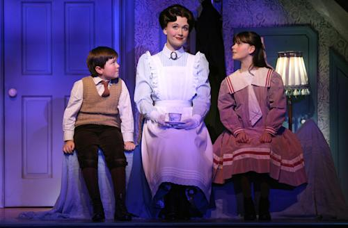"FILE - This file theater publicity image provided by Disney Theatricals shows, from left, Neil McCaffrey, Scarlett Strallen and Cassady Leonard in a scene from ""Mary Poppins,"" in New York. The six-year old musical will end performances in March at the New Amsterdam Theatre and eventually be replaced by a musical adapted from the film ""Aladdin."" (AP Photo/Disney Theatricals, Joan Marcus)"