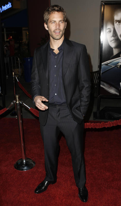 """FILE - In this March 12, 2009 file photo, actor Paul Walker arrives at the premiere of """"Fast & Furious"""" in Los Angeles. Walker is in New Orleans for the making of the suspense thriller, """"Hours."""" The film is about a father struggling to keep his newborn daughter alive in a New Orleans hospital ravaged during Hurricane Katrina. """"The Fast and the Furious"""" star plays the role of Nolan, a father trying to keep his daughter alive in an incubator through power outages, rising water and descending chaos. """"Hours"""" will be filming in New Orleans and other parts of Louisiana for about a month. (AP Photo/Matt Sayles, file)"""
