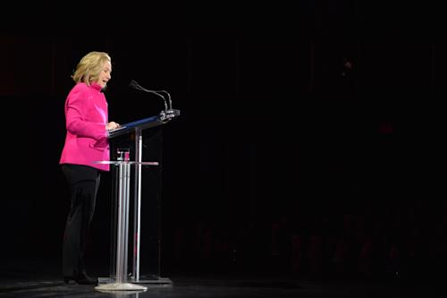 "This image released by Women in the World shows former Secretary of State Hillary Rodham Clinton speaking at the Women in the World Conference on Friday, April 5, 2013 in New York. Clinton said Friday that the rights of women represent ""the unfinished business of the 21st century"" in the United States and around the world, receiving a rapturous reception for one of her first speeches since departing the Obama administration. (AP Photo/Women in the World, Marc Bryan-Brown)"