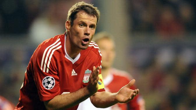Jamie Carragher (Liverpool) - Jamie Carragher merupakan pemain yang sangat loyal bersama Liverpool. Ia memulai sepak bola dan menghabiskan karier bersama Liverpool tanpa pernah berpindah klub. (AFP/Paul Ellis)