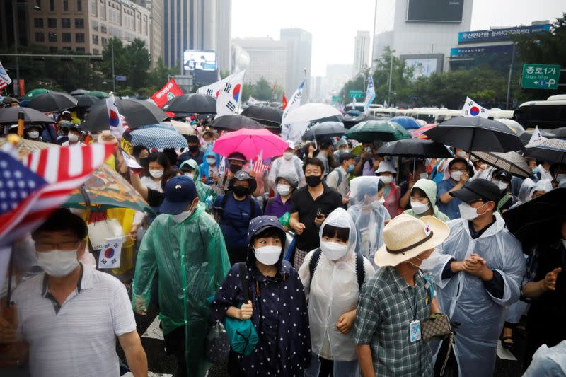 Thousands protest against Moon as Seoul scrambles to curb virus resurgence