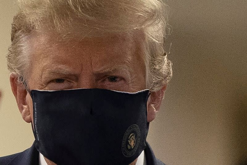 Trump bashes U.S. health experts, Fauci urges caution, as virus cases surge
