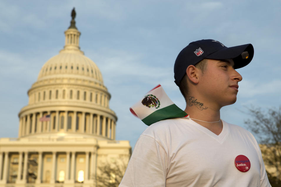 """Daniel Ramirez, 24, who is originally from Mexico and lives in Washington, poses for a portrait after attending the """"Rally for Citizenship,"""" a rally in support of immigration reform, on Capitol Hill in Washington, on Wednesday, April 10, 2013. Bipartisan groups in the House and Senate are said to be completing immigration bills that include a pathway to citizenship for the nation's 11 million immigrants with illegal status. """"I recently became a resident,"""" says Ramirez, """"so I was one of those kids who was brought here when I was 8 years old, and I can finally go to college."""" The tattoo on his neck is the name of his four-year-old daughter, Eileen. (AP Photo/Jacquelyn Martin)"""