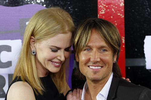 Nicole Kidman, left, and Keith Urban arrive at the 2013 CMT Music Awards at Bridgestone Arena on Wednesday, June 5, 2013, in Nashville, Tenn. (Photo by Wade Payne /Invision/AP)