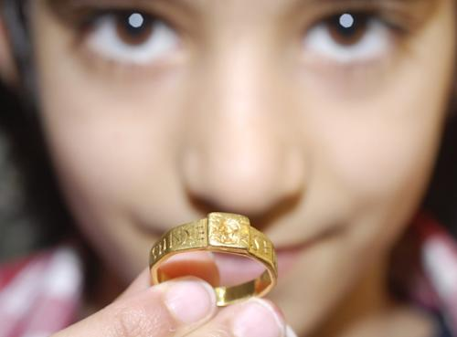 """This is National Trust undated handout photo made available on Tuesday April 2, 2013, of a Roman gold ring that could have inspired J.R.R Tolkien to write """"The Hobbit"""" and """"The Lord of the Rings"""" is going on exhibition in England. Found in a field in southern England in 1785, the ring is linked to a Roman tablet inscribed with a curse on the thief who stole it. That tablet was found at the site of a Roman temple dedicated to the god Nodens in Gloucestershire, western England. Tolkien worked on the etymology of the name Nodens in 1929 and visited the temple several times. (AP Photo/ Helen Sanderson/National Trust/PA ) UNITED KINGDOM OUT NO SALES NO ARCHIVE"""