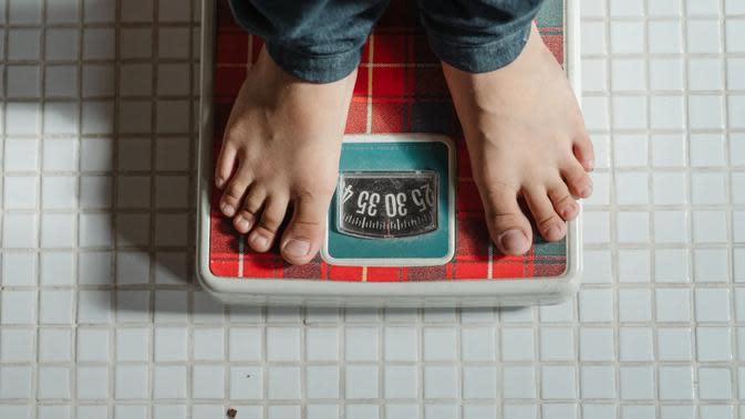 Ilustrasi turunkan berat badan. (dok. Ketut Subiyanto/Pexels/Brigitta Bellion)