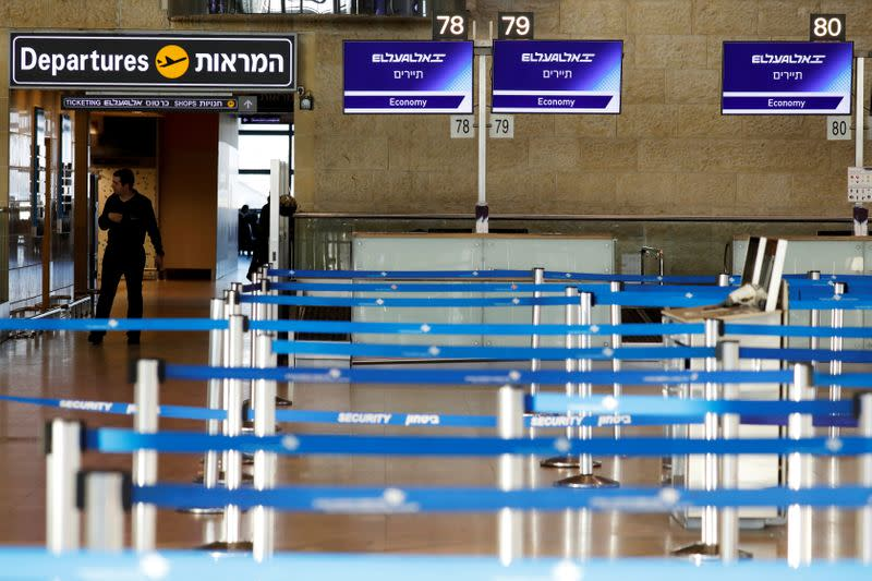 FILE PHOTO: Empty El Al Israel Airlines check-in counters are seen at Ben Gurion International airport in Lod, near Tel Aviv, Israel