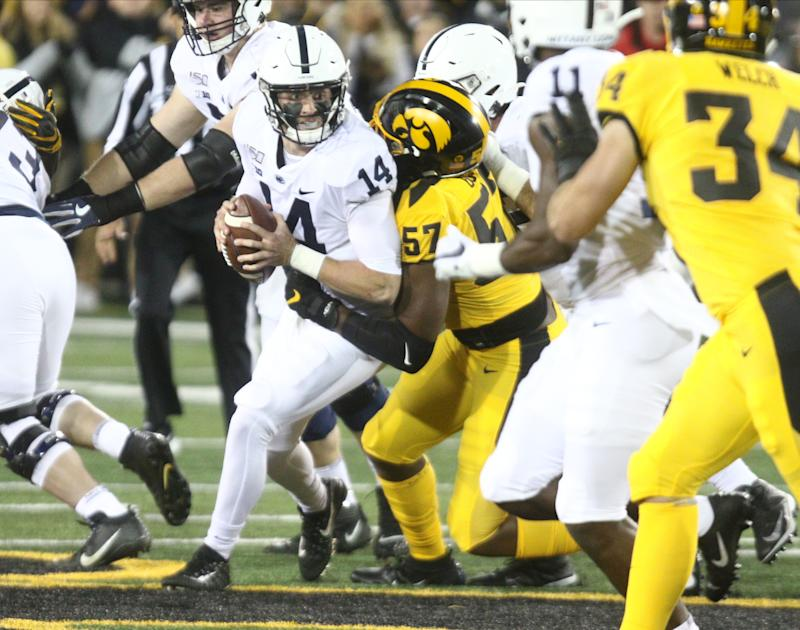 IOWA CITY, IOWA- OCTOBER 12: Quarterback Sean Clifford #14 of the Penn State Nittany Lions is sacked in the first half by defensive lineman Chauncey Golston #57 of the Iowa Hawkeyes, on October 12, 2019 at Kinnick Stadium in Iowa City, Iowa. (Photo by Matthew Holst/Getty Images)