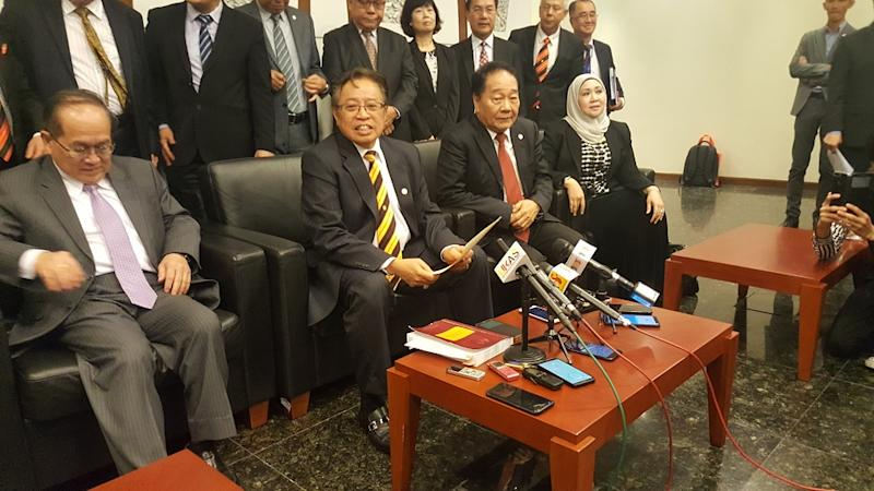 Sarawak Chief Minister Datuk Patinggi Abang Johari Openg (seated, centre) speaking to reporters after chairing the Sarawak Consultative Committee on Malaysia Agreement and Federal Constitution January 3, 2019. — Picture by Sulok Tawie
