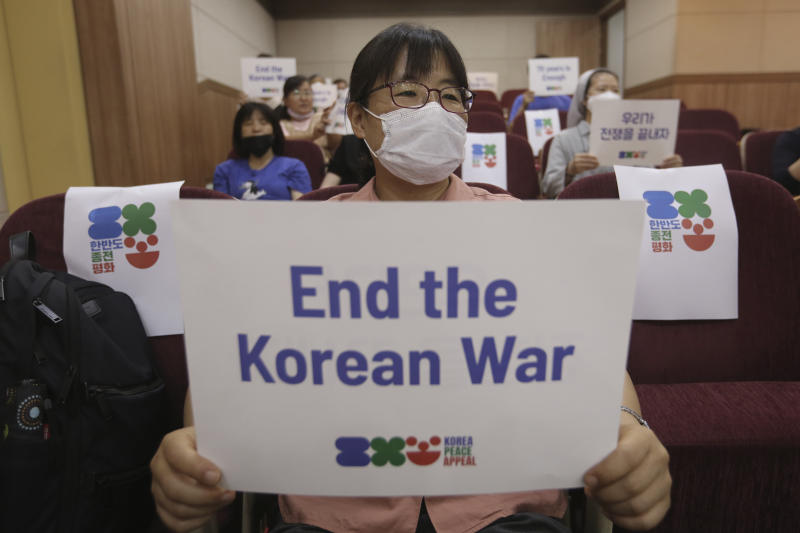 An anti-war activist holds a card during a press conference to demand the peace on the Korean peninsula on the eve of the 70th anniversary of the outbreak of the Korean War in Seoul, South Korea, Wednesday, June 24, 2020. North Korean leader Kim Jong Un suspended his military's plans to take unspecified retaliatory action against South Korea, state media said Wednesday, possibly slowing a pressure campaign against its rival amid stalled nuclear negotiations with the Trump administration. (AP Photo/Ahn Young-joon)
