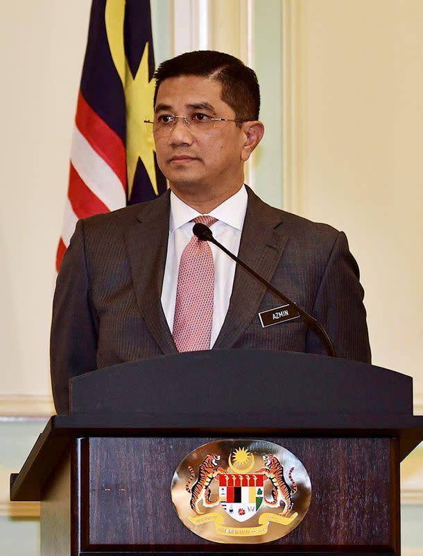 Malaysia's attorney-general drops sex-video case; minister denounces plot
