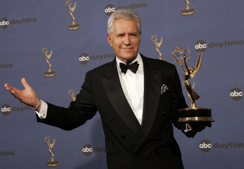 "FILE- In this Friday, April 28, 2006, file photo, Alex Trebek holds the award for outstanding game show host, for his work on ""Jeopardy!"" backstage at the 33rd Annual Daytime Emmy Awards in Los Angeles. Sony Television spokeswoman Paula Askanas said Sunday, June 24, 2012, that Trebek is in a Los Angeles hospital recovering from a mild heart attack. (AP Photo/Reed Saxon, File)"