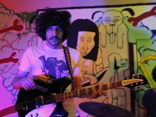 This 2012 photo shows Yellow Dogs band member, guitarist Soroush Farazmand at the Death By Audio performance space in the Brooklyn borough of New York. Police say a musician who shot and killed three other Iranian men inside a New York City apartment before committing suicide was upset because he had been kicked out of an indie rock band. Ali Akbar Mohammadi Rafie gunned down the men just after midnight on Monday, Nov. 11, 2013. Victims Soroush and Arash Farazmand were brothers who played in a band called the Yellow Dogs. The third victim, Ali Eskandarian was also a musician. After the shooting, investigators found a guitar case on a rooftop they believe the shooter may have used to carry the assault rifle used in the attack.(AP Photo/Danny Krug) NO SALES