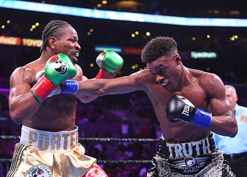 LOS ANGELES, CA - SEPTEMBER 28: Erroll Spence Jr (black/white trunks) and Shawn Porter (white/gold trunks) exchange punches during their IBF & WBC World Welterweight Championship fight at Staples Center on September 28, 2019 in Los Angeles, California. Spence, Jr won by decision. (Photo by Jayne Kamin-Oncea/Getty Images)