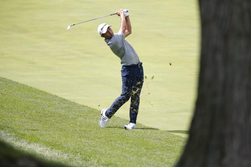 Golf: Morikawa tames stormy Muirfield to extend lead