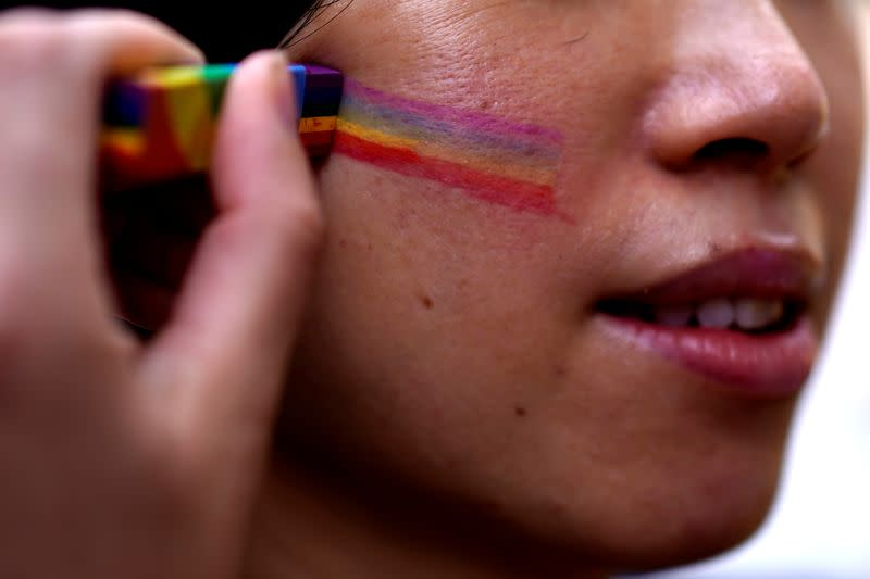 A participant takes part in a Pride Run during the Shanghai Pride festival, in Shanghai