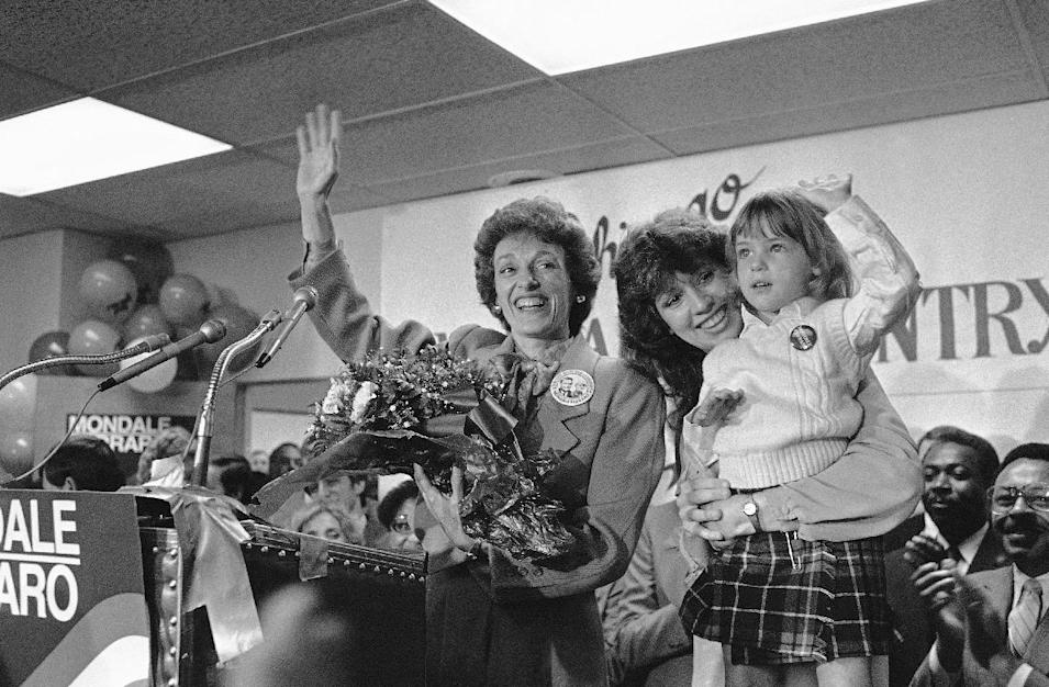 """FILE - In this Sept. 10, 1984 file photo, Joan Mondale, wife of the Democratic presidential candidate Walter Mondale, center, waves to the campaign workers gathered at the Illinois headquarters for the Mondale-Ferraro election effort, in Chicago. Mondale is flanked by campaign worker Julie Grace, holdings Lauren Jascula, who also wanted to show her support. Joan Mondale, who burnished a reputation as """"Joan of Art"""" for her passionate advocacy for the arts while her husband was vice president and a U.S. ambassador, died Monday, Feb. 3, 2014. She was 83. (AP Photo/Charlie Knoblock, File)"""