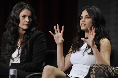 "Jenna Dewan-Tatum, right, a cast member in the Lifetime series ""Witches of East End,"" answers a question as fellow cast member Julia Ormond looks on during the Lifetime 2013 Summer TCA press tour on Friday, July 26, 2013, in Beverly Hills, Calif. (Photo by Chris Pizzello/Invision/AP)"