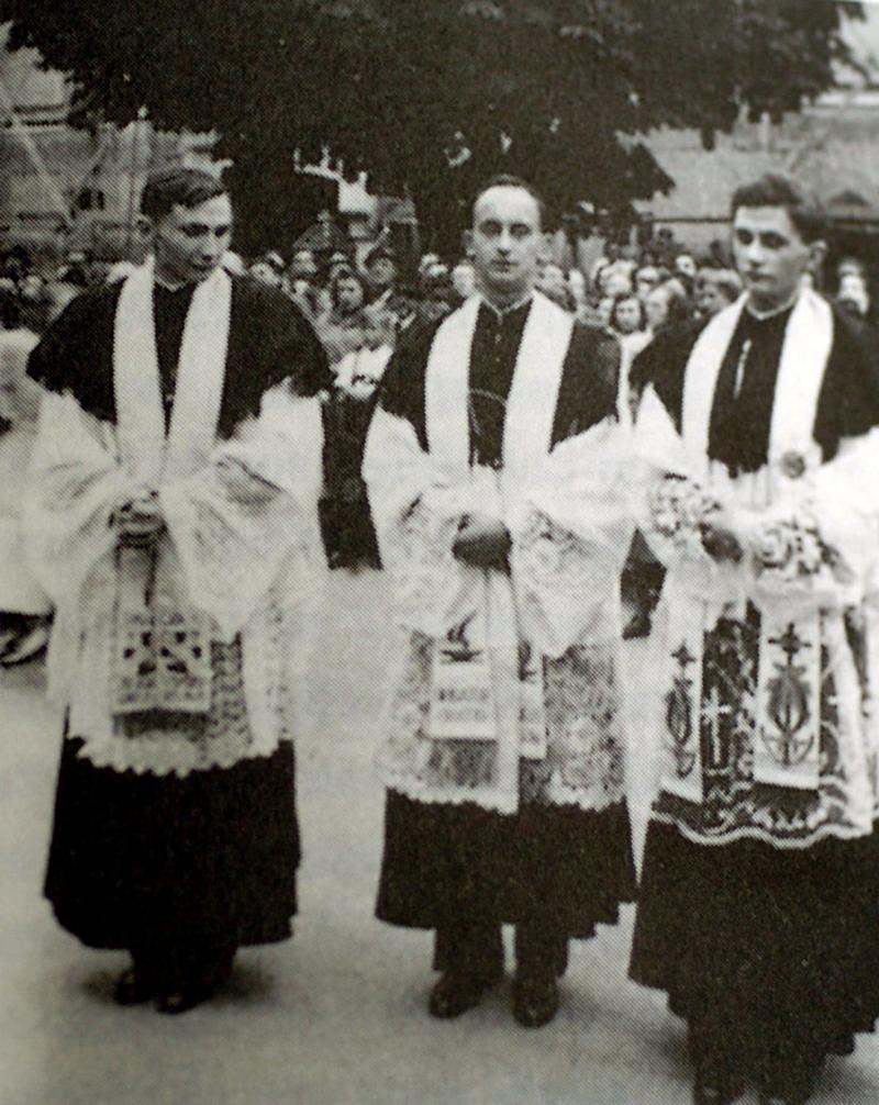 George, left, with Joseph, right, newly ordained in 1951 - Reuters