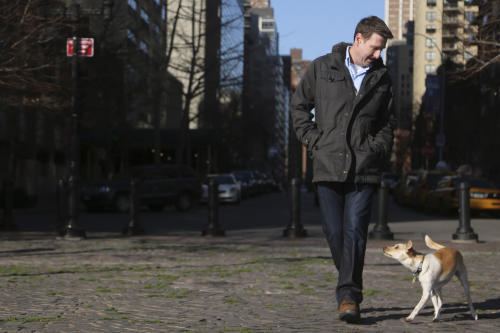 "In this Saturday, Jan. 19, 2013 photo, Michael Wright and his dog Toby (formerly called Fumble) pose for a portrait in New York. ""Puppy Bowl,"" an annual two-hour TV special that mimics a football game with canine players, made its debut eight years ago on The Animal Planet. ""It raises awareness for our shelter and others that take part,"" said Madeline Bernstein, president and CEO of the Society for the Prevention of Cruelty to Animals Los Angeles. ""A lot of people have come in during the last year and said, 'I want a dog just like Fumble,'"" she said, referring to spcaLA's entry in ""Puppy Bowl VIII"" who earned the game's Most Valuable Pup crown. (AP Photo/Mary Altaffer)"