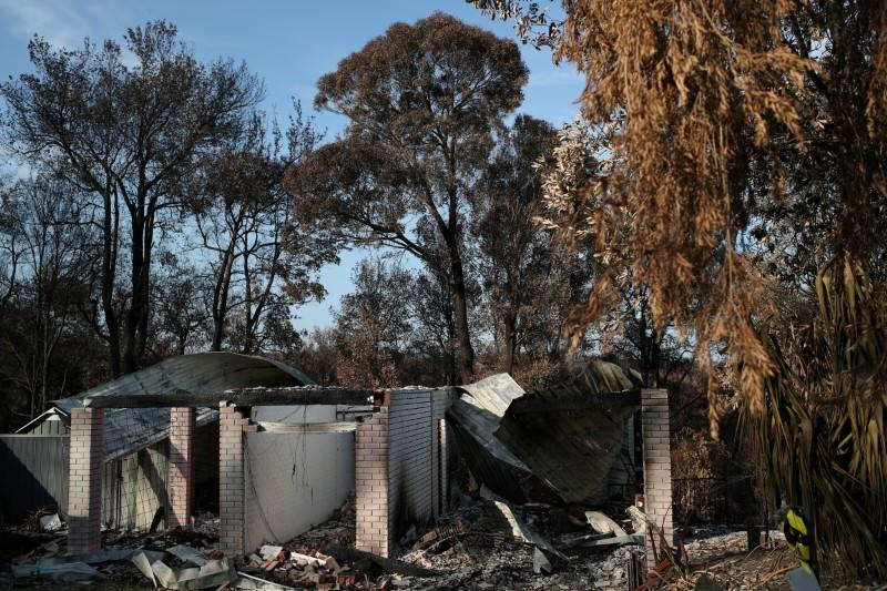 The remnants of a destroyed home, burnt in the recent bushfires, is pictured in Conjola Park