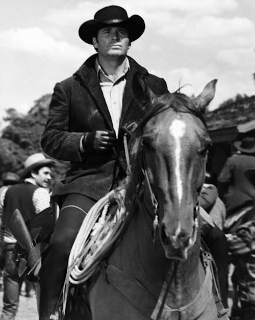 "FILE - James Garner as Australia- bound Jason McCullough rides into gold-rush boom town of Calendar in this April 1968 file photo taken at MGM Studios. Actor James Garner, wisecracking star of TV's ""Maverick"" who went on to a long career on both small and big screen, died Saturday July 19, 2014 according to Los angeles police. He was 86.(AP Photo/File)"