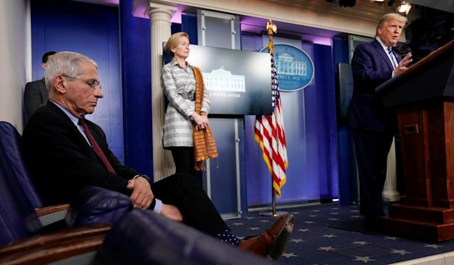 White House medical advisers Dr Anthony Fauci and Dr Deborah Birx listen as US President Donald Trump addresses the daily coronavirus task force briefing. Photo: Reuters