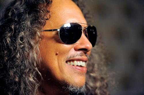 "Kirk Hammett, of musical group Metallica, speaks to media at the ""Metallica Through the Never"" press line on Day 3 of Comic-Con International on Friday, July 19, 2103 in San Diego, Calif. (Photo by Chris Pizzello/Invision/AP)"