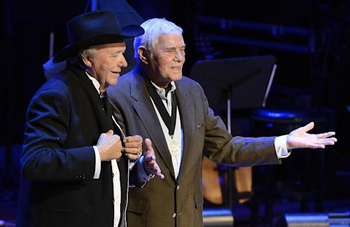 "Country music star Bobby Bare was inducted by Tom T. Hall, right, after he was presented with his County Music Hall of Fame medallion and plaque at the ceremony for the 2013 inductions into the Country Music Hall of Fame on Sunday, Oct. 27, 2013, in Nashville, Tenn. The inductees are Bobby Bare, the late ""Cowboy"" Jack Clement and Kenny Rogers. (AP Photo/Mark Zaleski)"