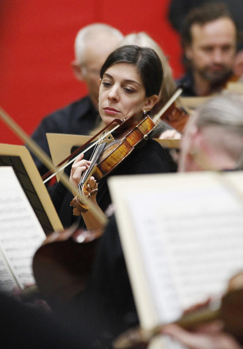 In this photo taken Monday, Sept. 24, 2012, Principal second violinist Gina DiBello of the Musicians of the Minnesota Orchestra performs during the ACME Concert, a free event at the North Community YMCA, in Minneapolis. The Minnesota Orchestra was called the world's greatest not long ago, welcome recognition for musicians outside a top cultural center. Now its members are locked out of Orchestra Hall, stuck in the same kind of labor-management battle recently afflicting teachers and football referees. (AP Photo/Stacy Bengs)