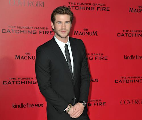 "FILE - In this Monday, Nov. 18, 2013 file photo, Liam Hemsworth arrives at the Los Angeles premiere of ""The Hunger Games: Catching Fire,"" held at the Nokia Theatre LA Live. The actor says he is, ""More comfortable in my own skin than I've ever been in my whole life."" Returning as Gale Hawthorne in the film releasing in theaters on Friday, Nov. 22, 2013, Hemsworth said hanging with the film's crew, especially co-star Jennifer Lawrence, also helps him stay positive. (Photo by Jordan Strauss/Invision/AP)"