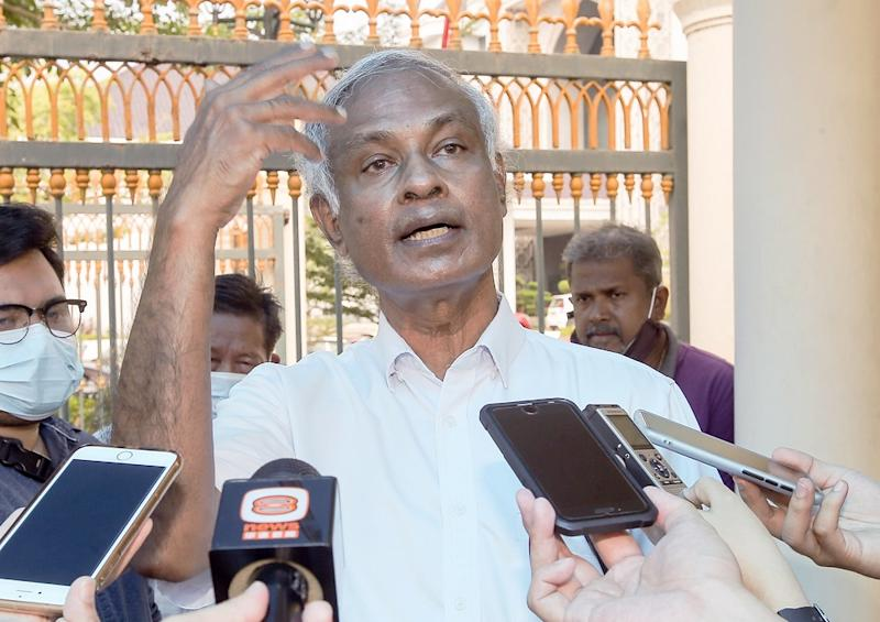 PSM chairman Dr Jeyakumar Devaraj speaks to reporters on the land issues faced by small-scale farmers in Perak in front of the State Secretariat Building in Ipoh July 15, 2020. ― Pictures by Farhan Najib