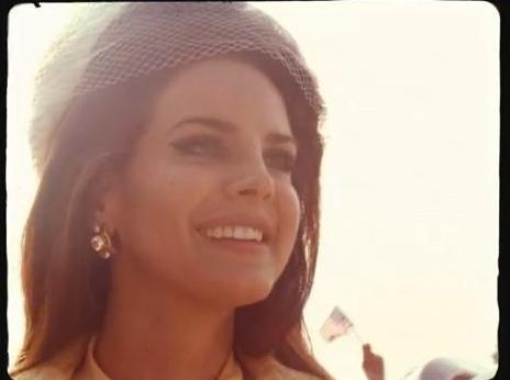 "Lana Del Rey Transforms Into Jackie Kennedy, Marilyn Monroe For Epic ""National Anthem"" Video"