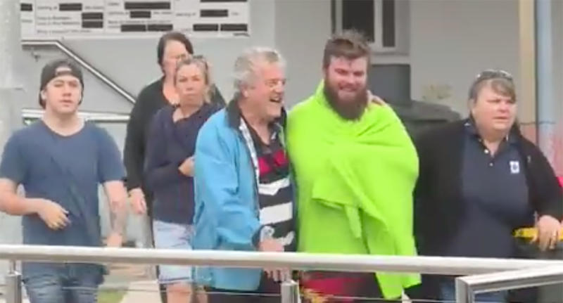 Members of the family that were on the boat are seen walking away.