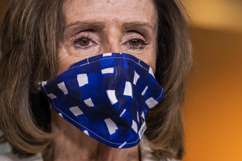 House Speaker Nancy Pelosi of Calif., listens to questions during a news conference on Capitol Hill, Thursday, April 30, 2020, in Washington. (AP Photo/Manuel Balce Ceneta)